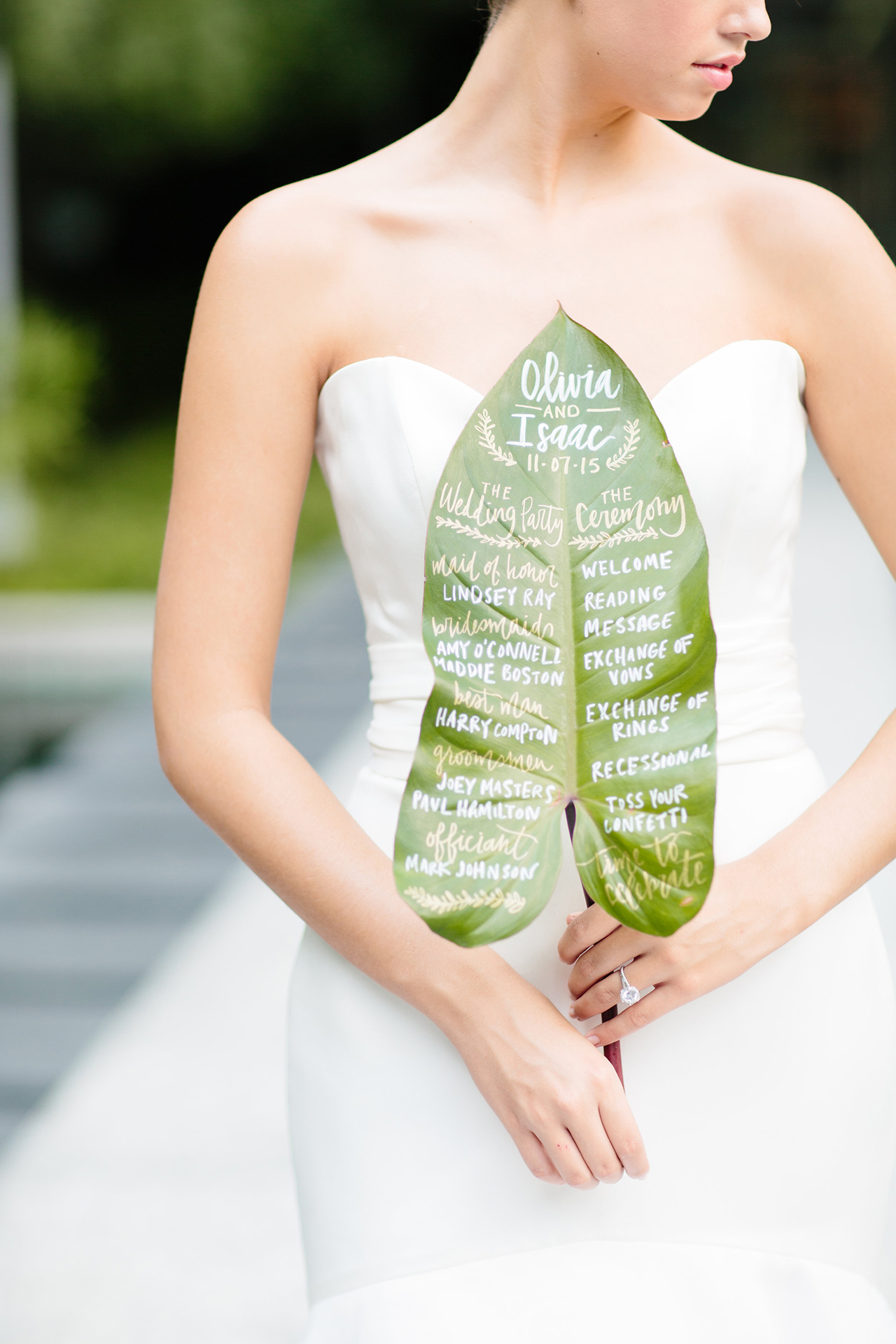 Custom one of a kind hand lettered wedding program on a tropical leaf for the summer shoot.