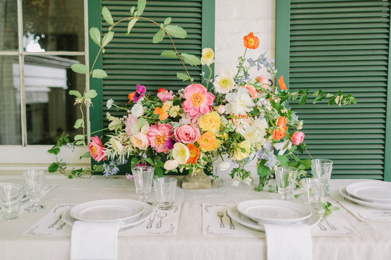 A full and bright floral centerpiece makes this table scape absolutely jaw dropping!