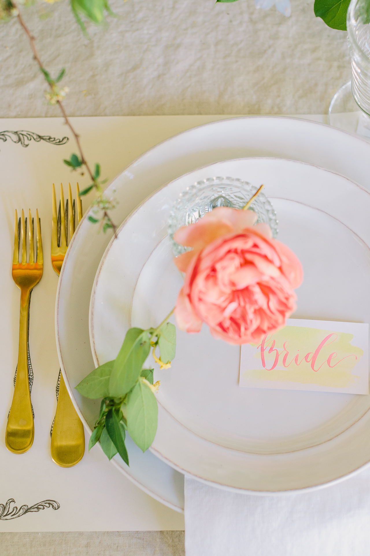 Yellow watercolor place card with metallic pink calligraphy details by Goldie Design Co.