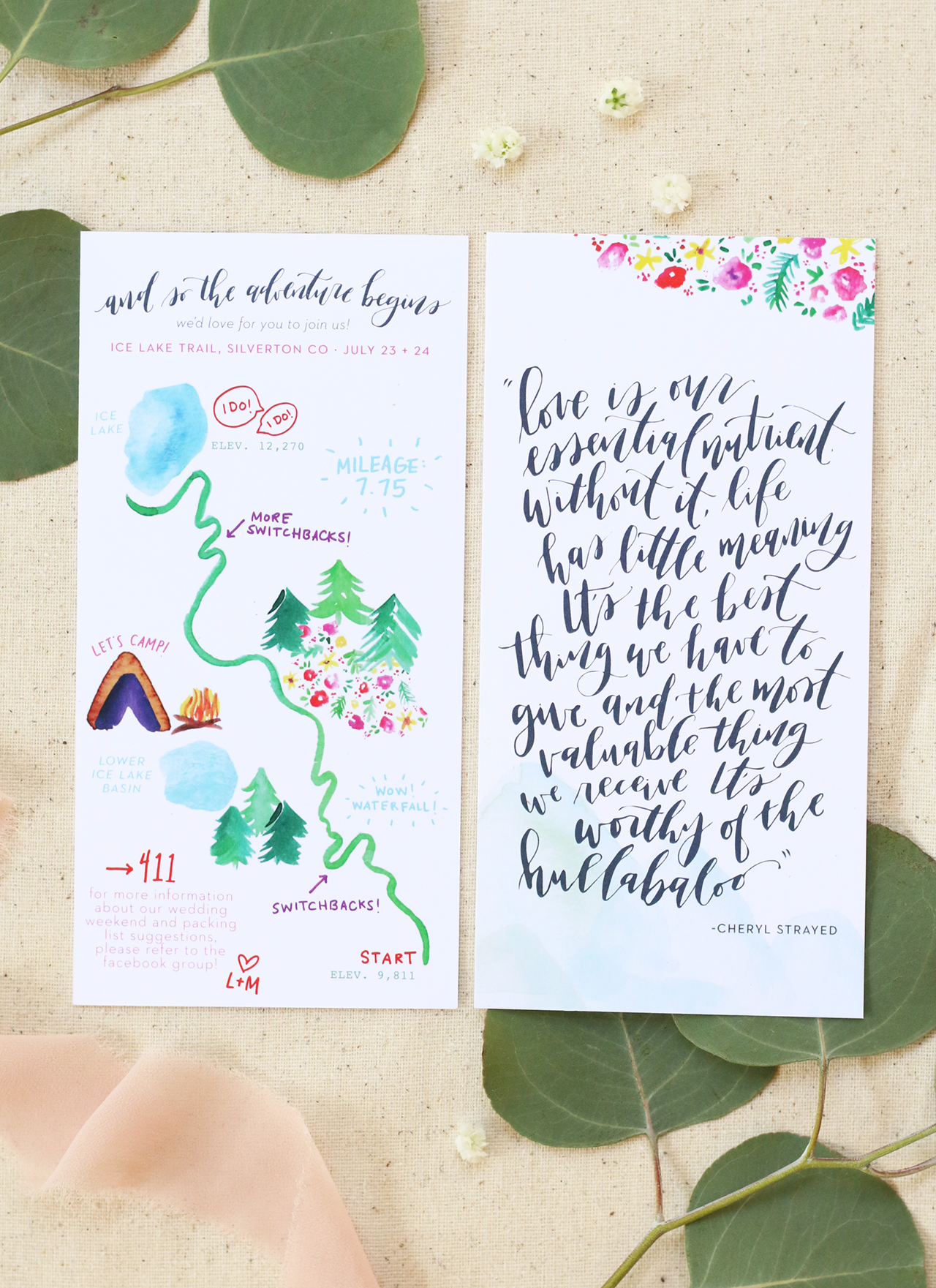 This map card doubled as a memento for guests to keep as a small piece of art. The couple wanted a meaningful quote to them lettered on the back. The front of the card was a custom watercolor of the trail they hiked to their ceremony location.