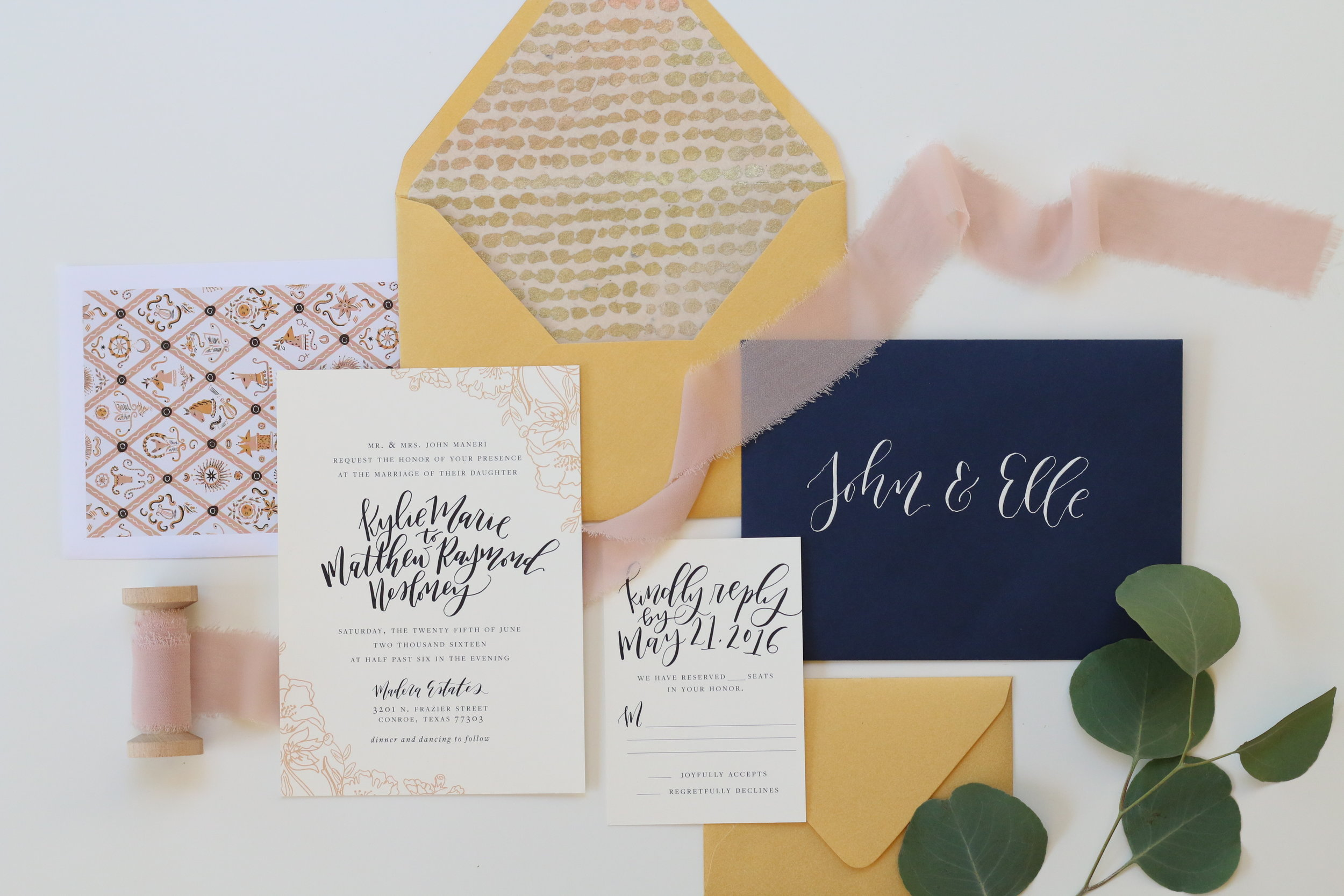 A classic navy and gold wedding invitation with beautiful calligraphy and light blush pink accents. for a Madera Estates Conroe, Texas wedding