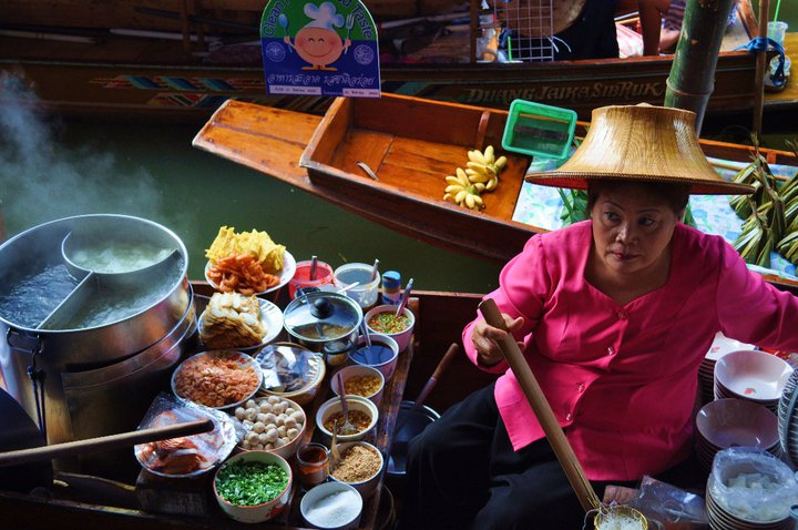 The floating market in Thailand is kind of a tourist trap. However, it's still pretty cool to see. And there's some delicious stuff being served up boat side.