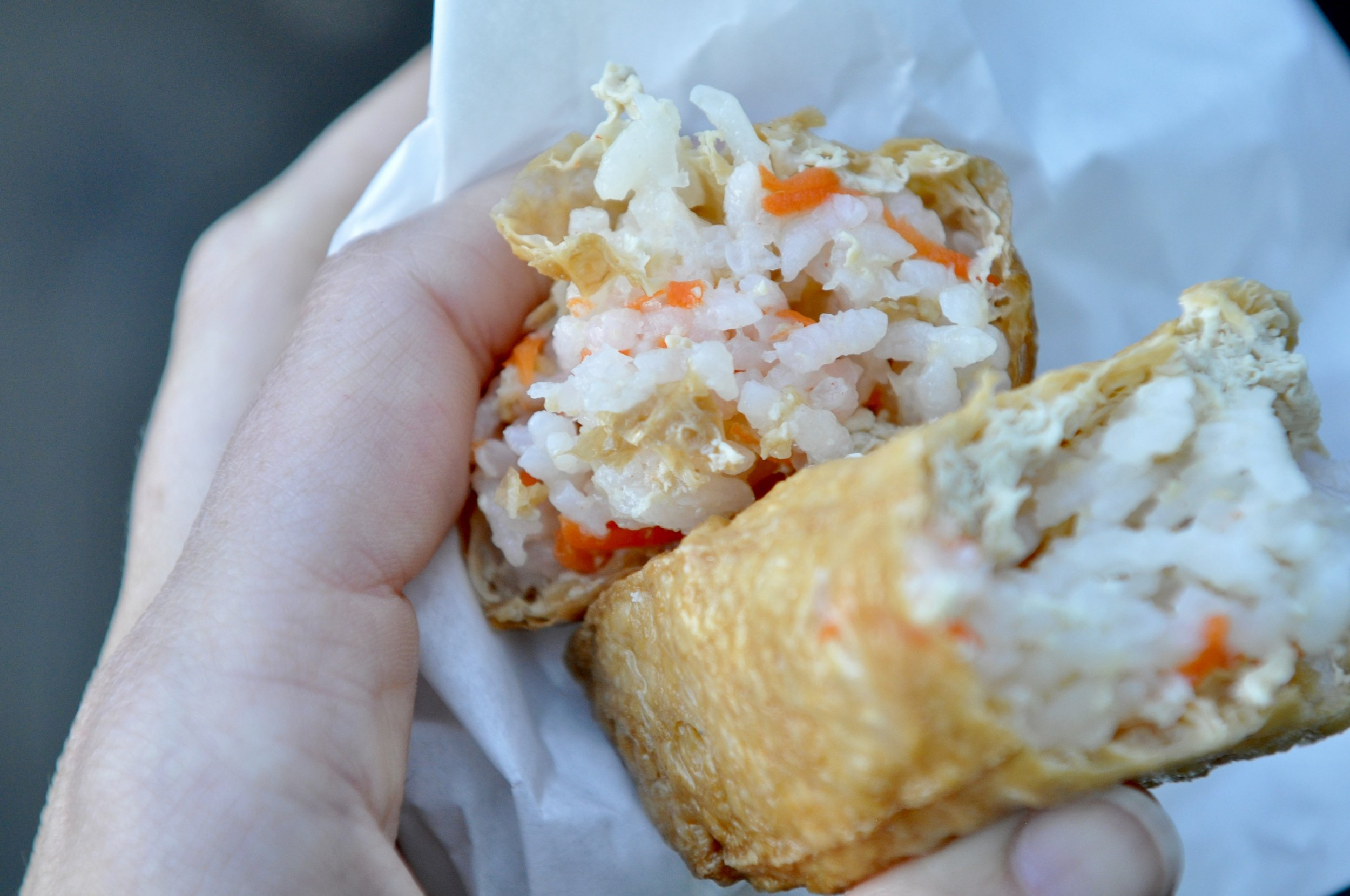 A sushi cone.It's basically fried tofu skin stuffed with white rice and egg