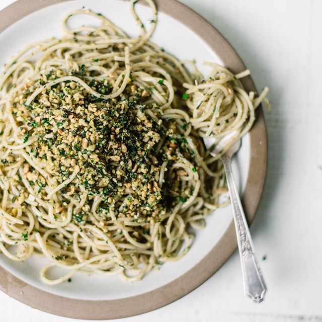 "Spaghetti ""con le noci"" is basically a simplified pesto and it's as good as it looks (when done right). It's the third recipe I whipped up as part of #thegianfrancoproject (see stories!) and it's perfect for a quick, delicious weeknight dinner in a pinch. . Maybe you've noticed, or maybe you haven't, but I've been off social media for a couple of weeks now. There's a lot happening on the personal front that has required me to have some space and time away from personal projects and social media. It's real life, yo.  Hope you'll accept this pasta as my apology ❤️ So, for dinner, you'll need: 6-8 ounces spaghetti  ½ cup walnuts ½ cup pine nuts ½ cup fresh basil, loosely packed ¼ cup fresh mint ¼ cup fresh parsley 3 tablespoons extra virgin olive oil  Salt, to taste Parmesan What you'll do: Toast the nuts in a dry skillet on low heat for two to four minutes, or until they are crunchy and fragrant.  Put the nuts in a food processor and the handfuls of fresh mint leaves, basil leaves and parsley. Make sure not to include any of the stems. Blend all the ingredients together, pulsing making sure that you don't wind up with a powdery consistency. It has to have some grain left to it. It will have a similar consistency to tabule.  Cook the spaghetti until al dente and place it in a bowl. Quickly coat the spaghetti with abundant olive oil of excellent quality. Add your nuts mixture to the spaghetti and stir together. The oil will make the mixture stick to the pasta. Top with freshly grated parmesan. ⠀⠀⠀⠀⠀⠀⠀⠀⠀ . #pasta #pastarecipe #pastaalpomodoro #onmytable #inseasonnow #heresmyfood #makeitdelicious#storyofmytable #foods4thought #realfood #theartofslowliving #feedfeed#shareyourtable #healthyish #f52grams#lifeandthyme #foodblogeats #thekitchn#foodandwine #bonappetit #foragebyfolk#mywilliamssonoma #fellowmag#hautecuisines #beautifulcuisines#foodgawker #wholefoodfaves #seriouseats #gloobyfood"