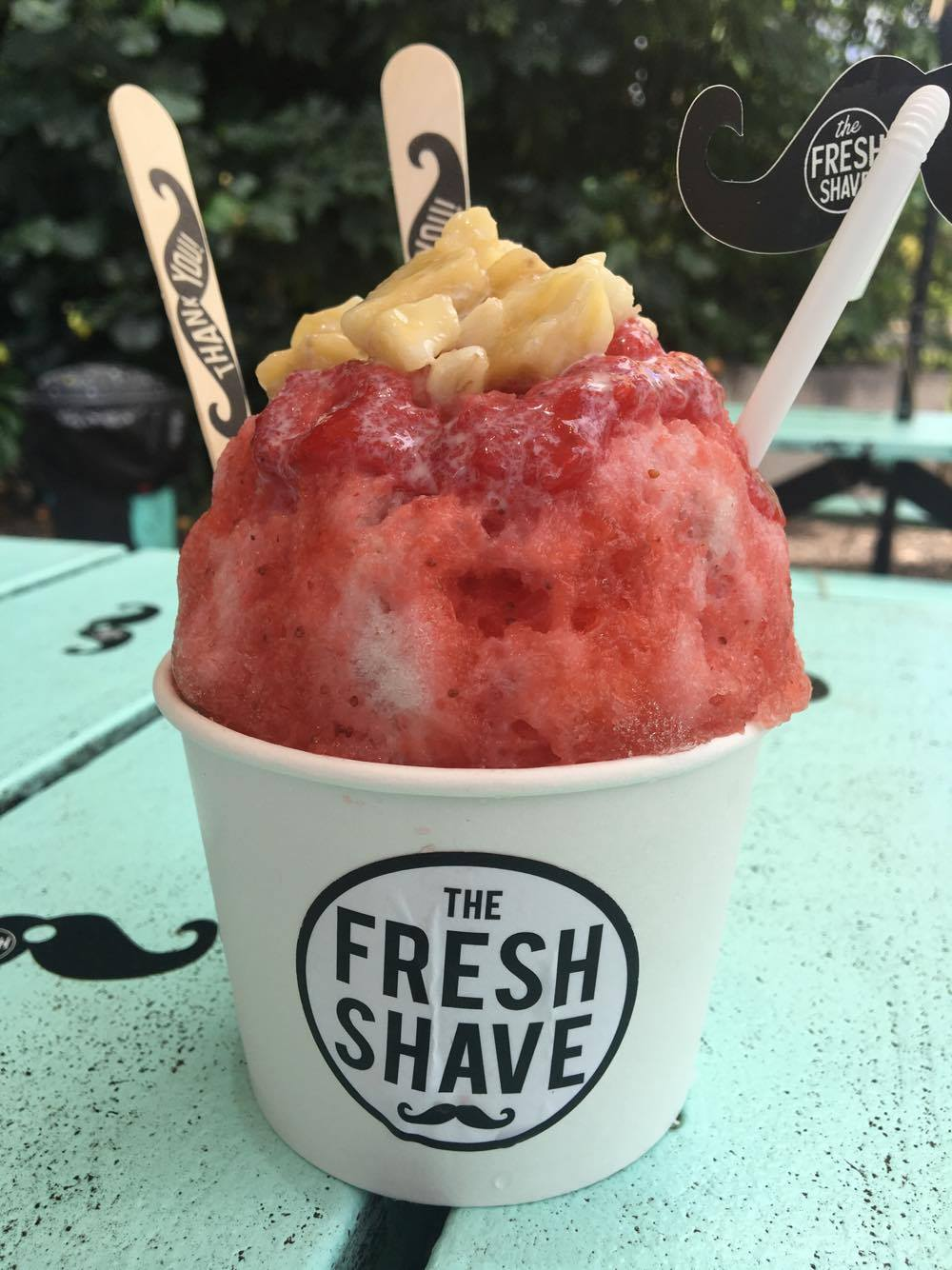 #4 The Fresh Shave  -                         Personal Favorite:                        The Fu Manchu  Strawberry, Banana & Cream topped with    fresh strawberry puree & bananas