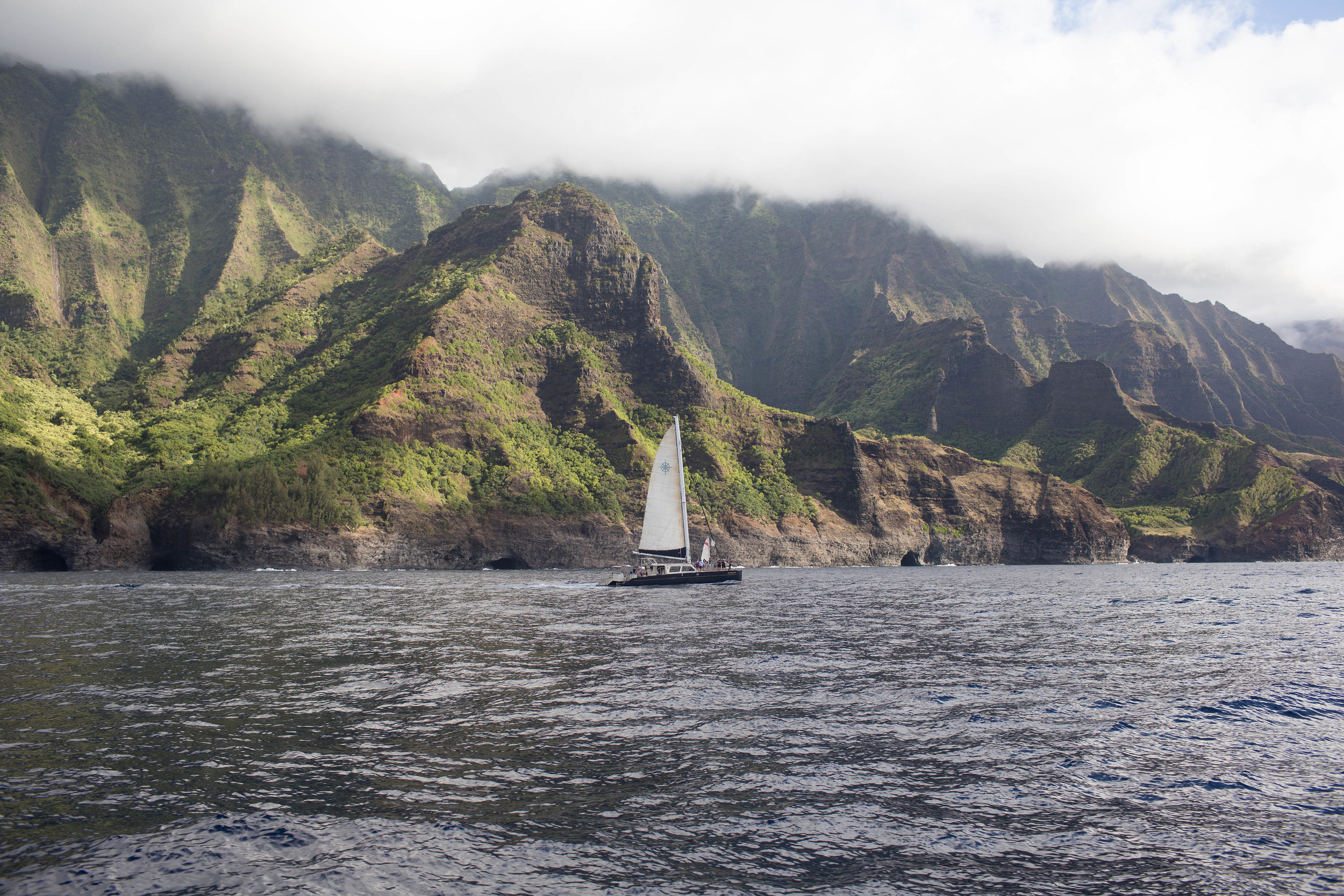 Nā Pali Coast  - This famous coastline features a 17 mile shore line, with beaches only accessible through the Kalalau Trail, (that 11 mile hike I previously mentioned). This photo was taken on our Holo Holo Charters boat tour that we've taken twice now and have loved. This coastline is a must during a trip to Kauai!