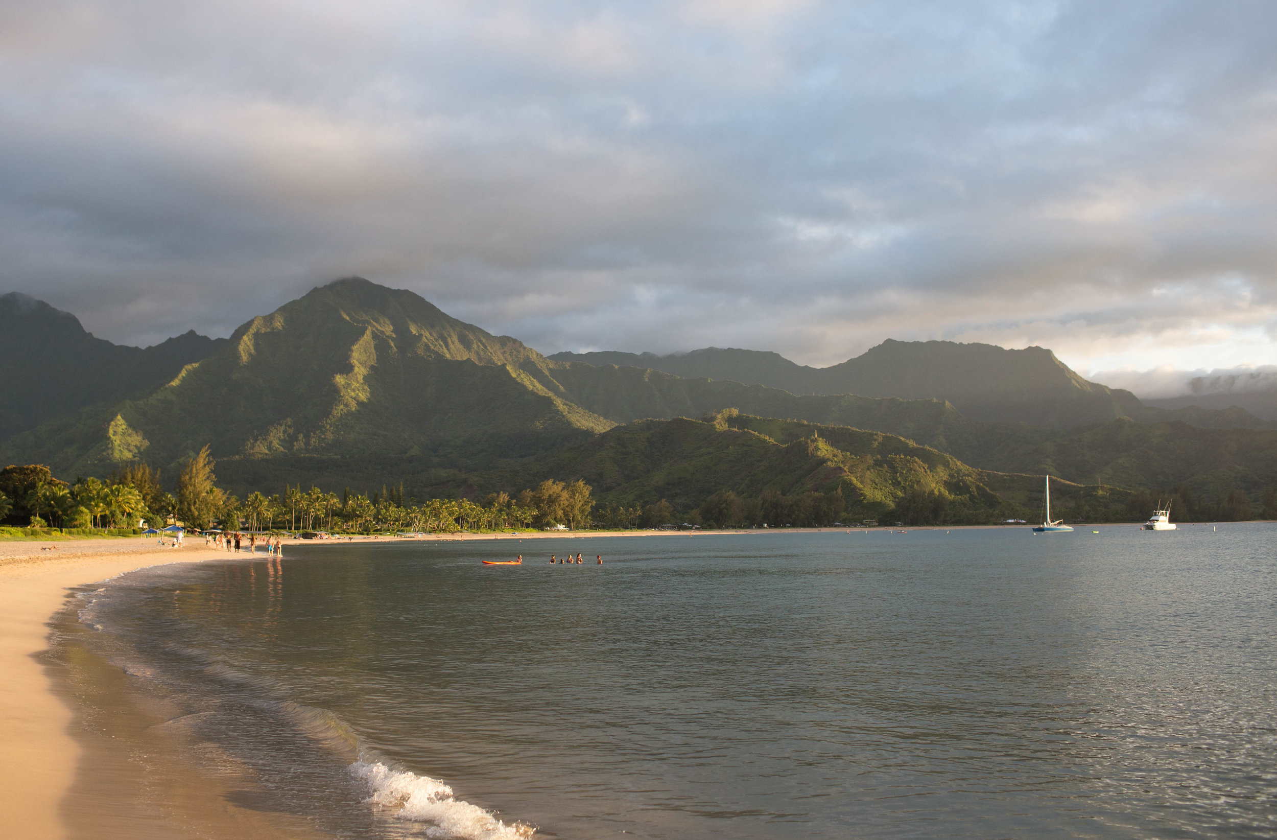 Hanalei Bay - Hanalei Bay lies on the north shore of the island stretching along roughly 2 miles of beaches. The town of Hanalei is easily one of our favorite spots on the island filled with shave ice, delicious food & great shops!