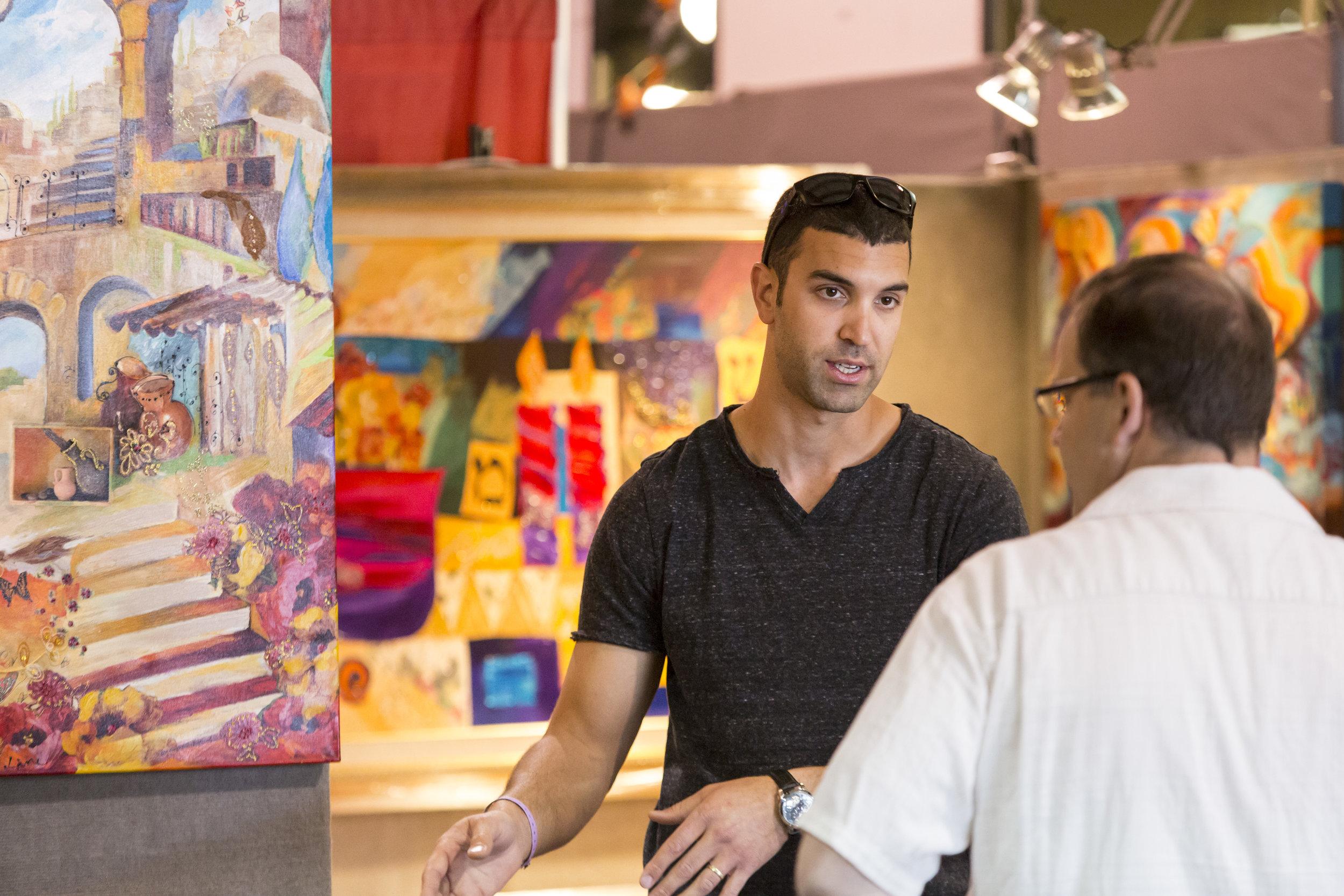 Fine artist Smadar Livne sells colorful fine art at Sugarloaf Crafts Festival