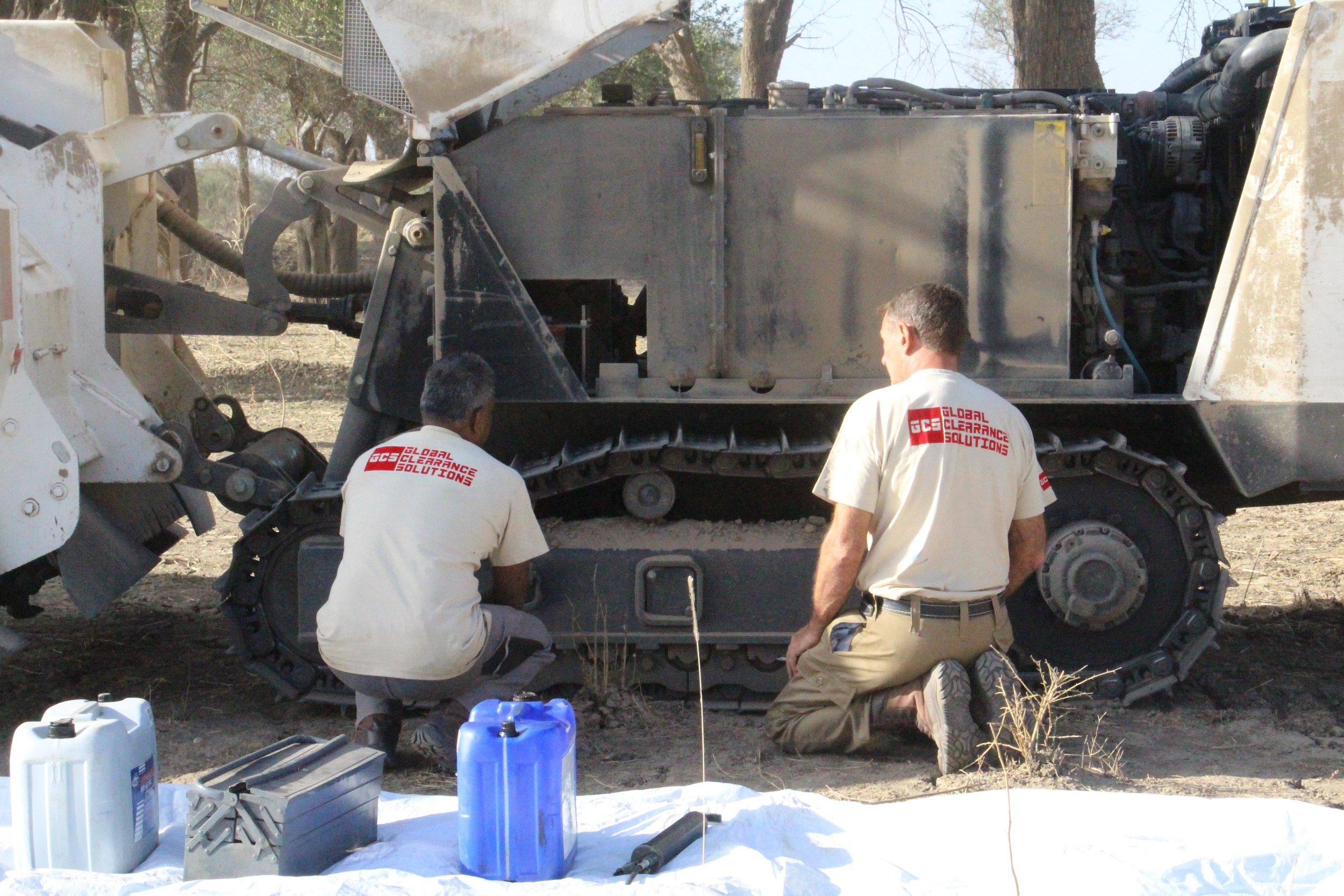 GCS FT maintaining a vehicle in Sudan (NXPowerLite-Kopie).JPG