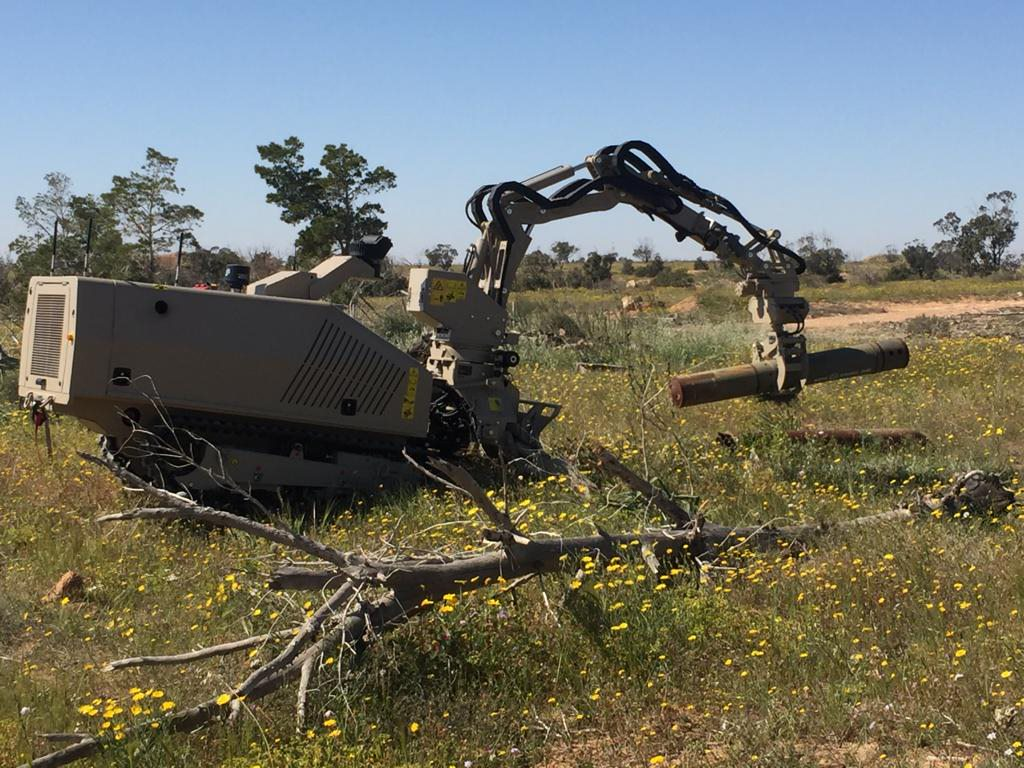 GCS-100 with the robotic arm attachment handling a large unexploded ordnance