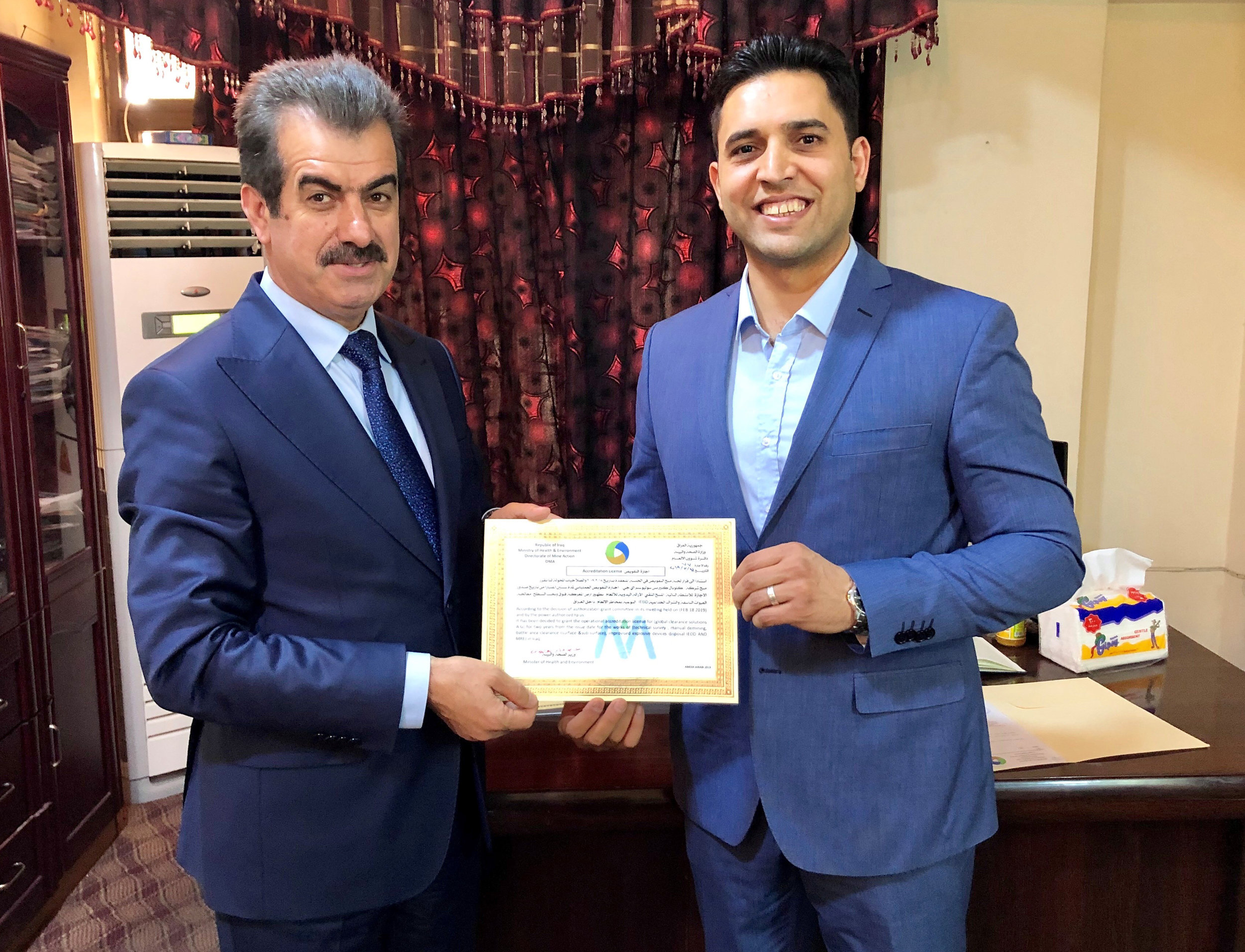 Dr Kamaran Ali Hassan , Deputy of the Minister of Health and Environment presents Wissam Allamy, GCS Iraq Branch Manager with DMA Accreditation