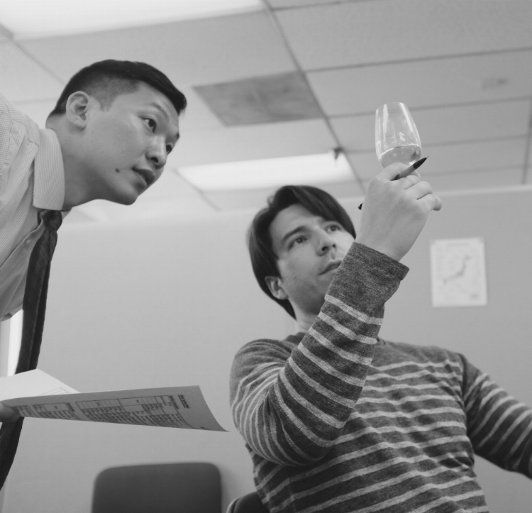 Master Eric walks through a tasting sheet with a student during the Sake Master Class in LA