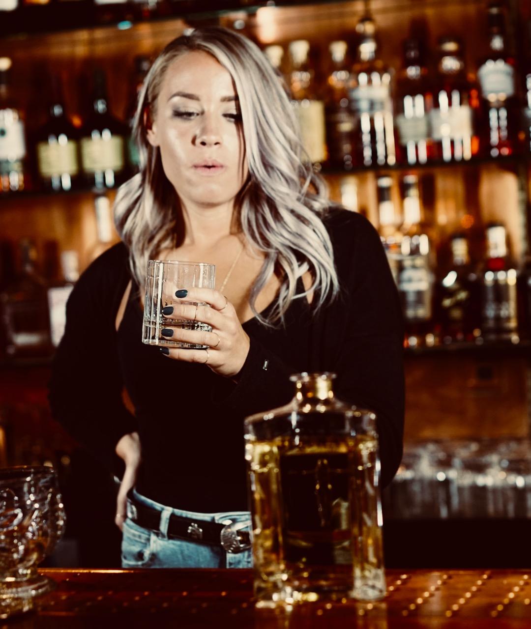 Katie Smith tastes Tavi Tequila Reposado
