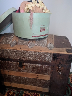Augusta's own silver-ornamented traveling trunk. She brought this with her to Colorado from Maine, where she grew up.