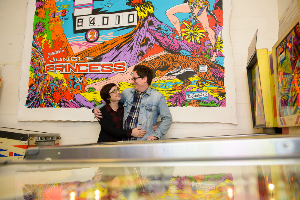 Nerdy couple at video game arcade
