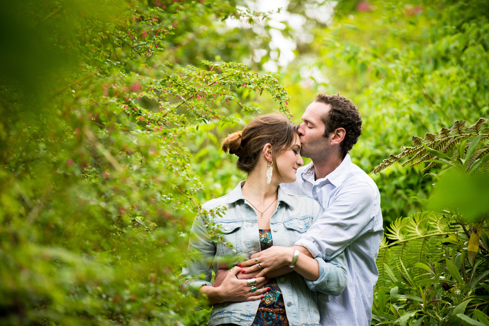Man kissing woman on the forehead at SF Botanical Garden