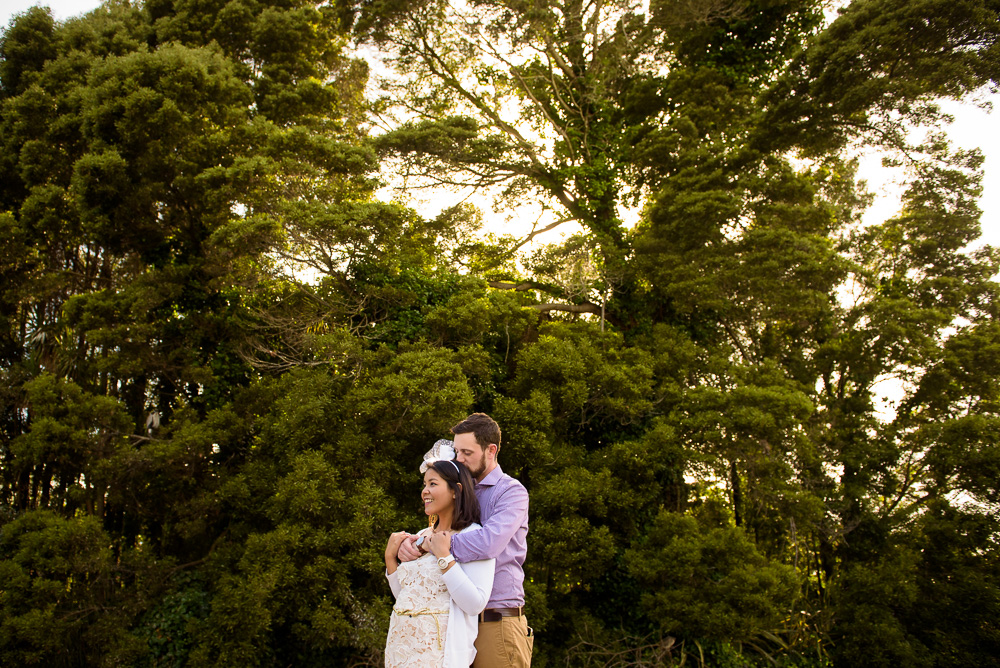 Couple embracing at Palace of Fine Arts