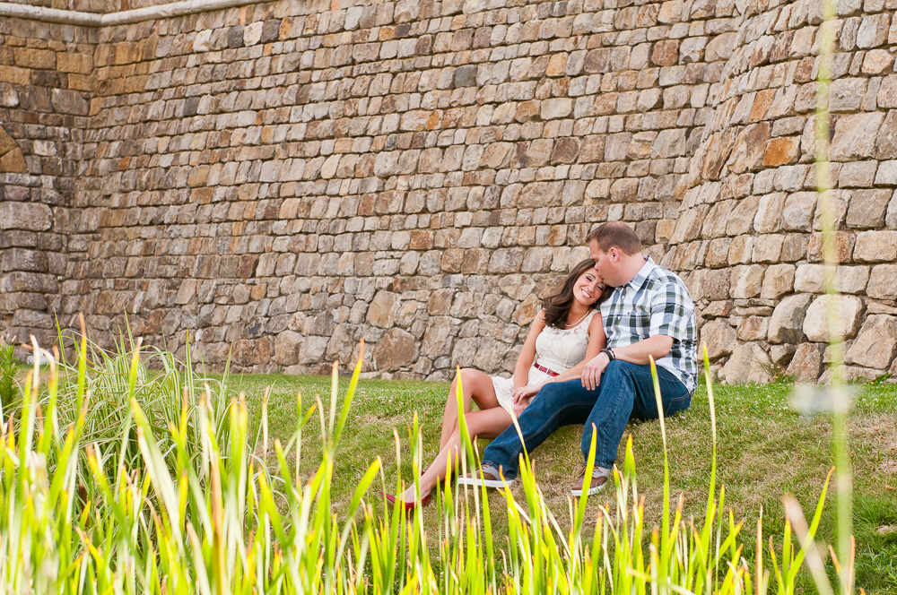 Couple in front of a rock wall in wine country