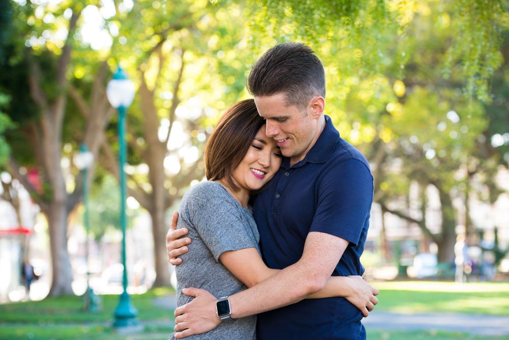 Couple hugging under a tree in San Francisco's North Beach neighborhood