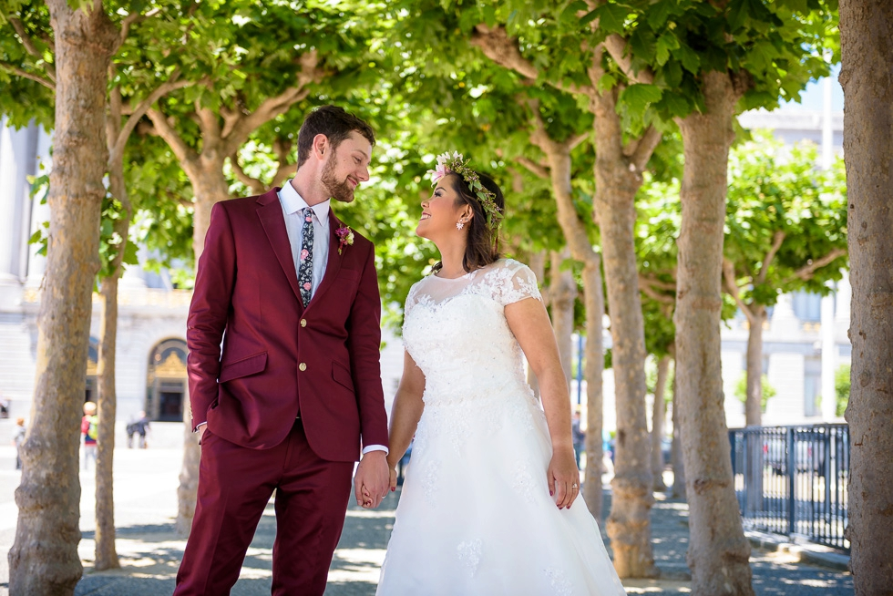 Bride and groom outside San Francisco City Hall