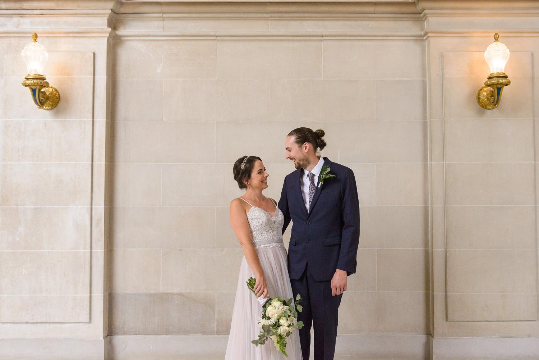 Couple smiling at San Francisco City Hall wedding