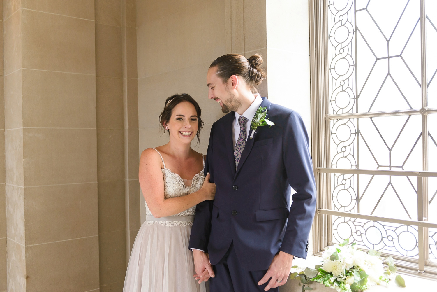 Bride and groom portrait at SF City Hall
