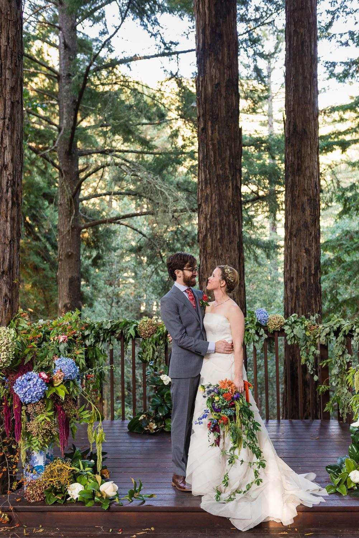 Bride and groom hugging in a Redwood grove