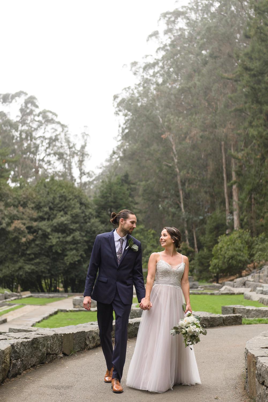 Bride and groom walking in San Francisco's Stern Grove
