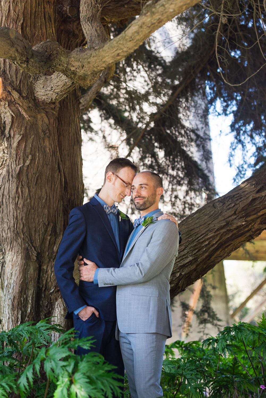 Two grooms hugging in San Francisco