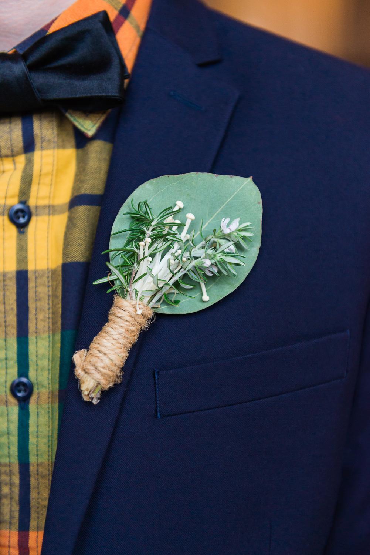 Mushroom boutonniere affixed to groom's jacket
