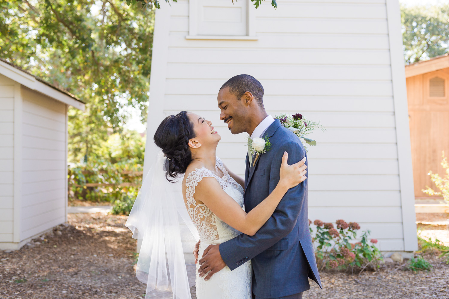 Bride and groom laughing after first look on wedding day in Walnut Creek