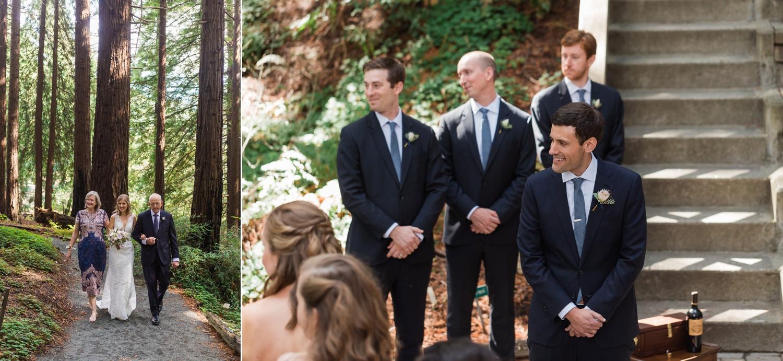 Bride walking down aisle and groom watching