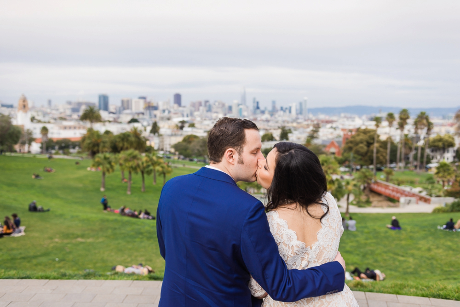 Bride and groom kissing at Dolores Park