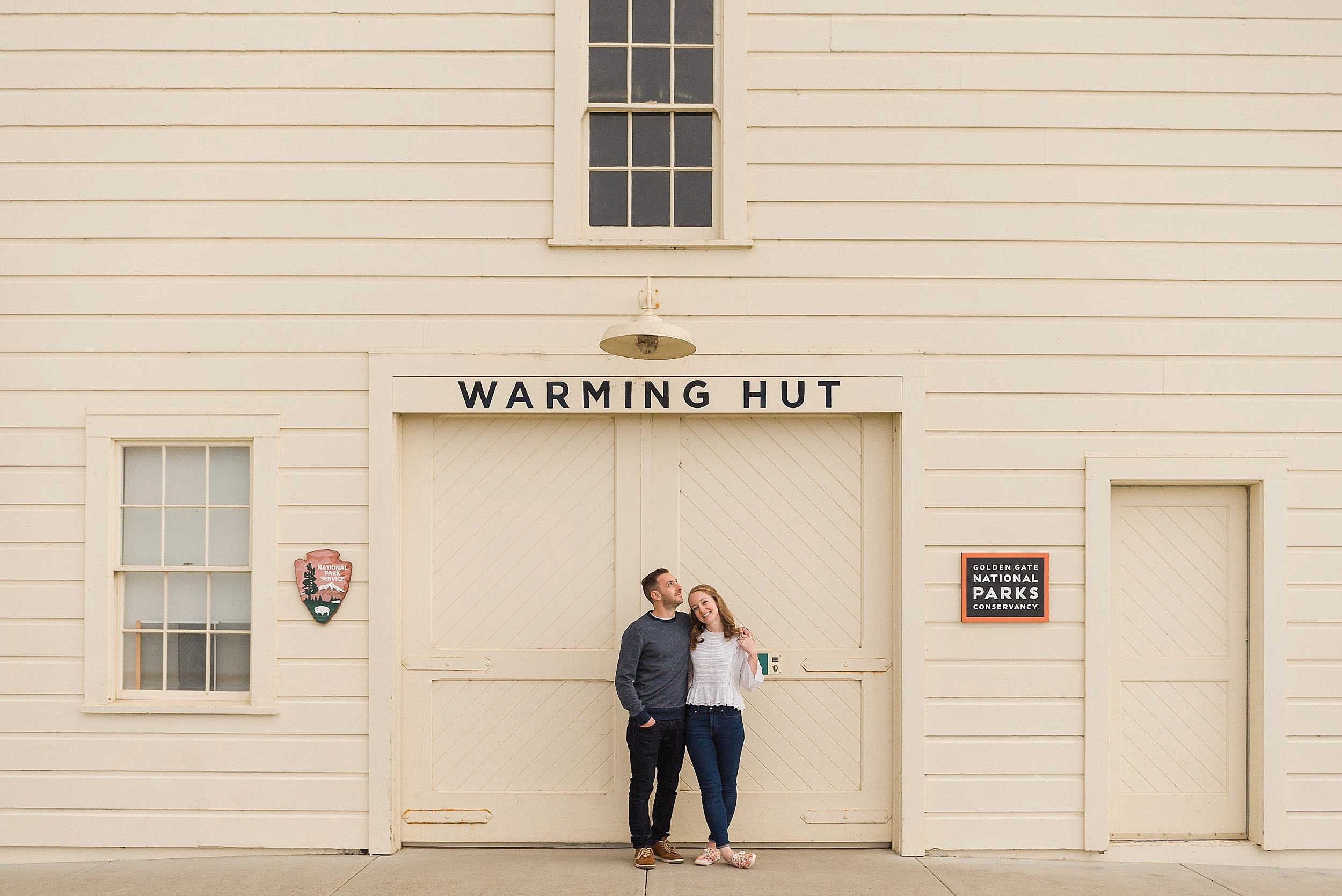 Couple standing in front of the Warming Hut at Crissy Field