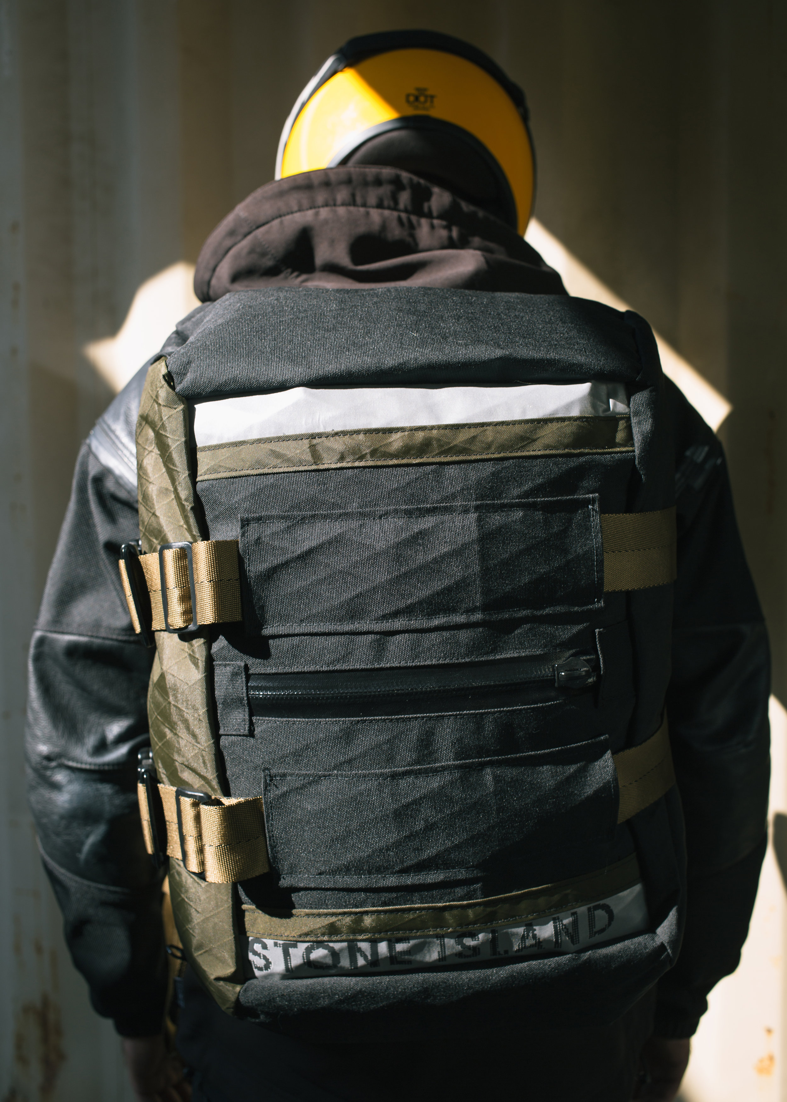 "dual 3M Scotchlite paneling on the rear with a centered ""cold storage pocket"". designed to hold those things that never leave your pack. say some tools or medical kit."