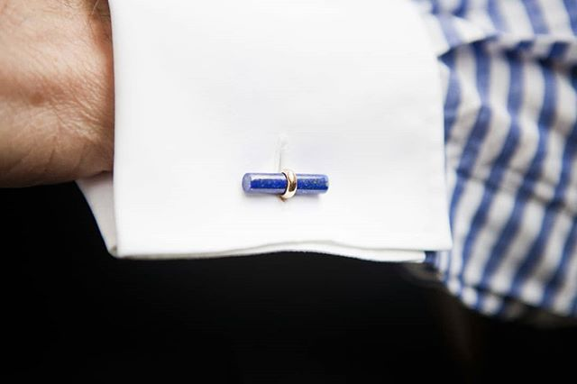 In view: Horizontal linen shirt with turnback cuffs by: @100hands.  Perfectly complimented by Van Cleef & Arples Interchangeable Baton Cufflinks Set from @hsbijoutiers private collection. Comprising of tigerseye, carnelian, onyx, lapis lazuli, malachite and 18k yellow gold set with cabochon Burma rubies batons.