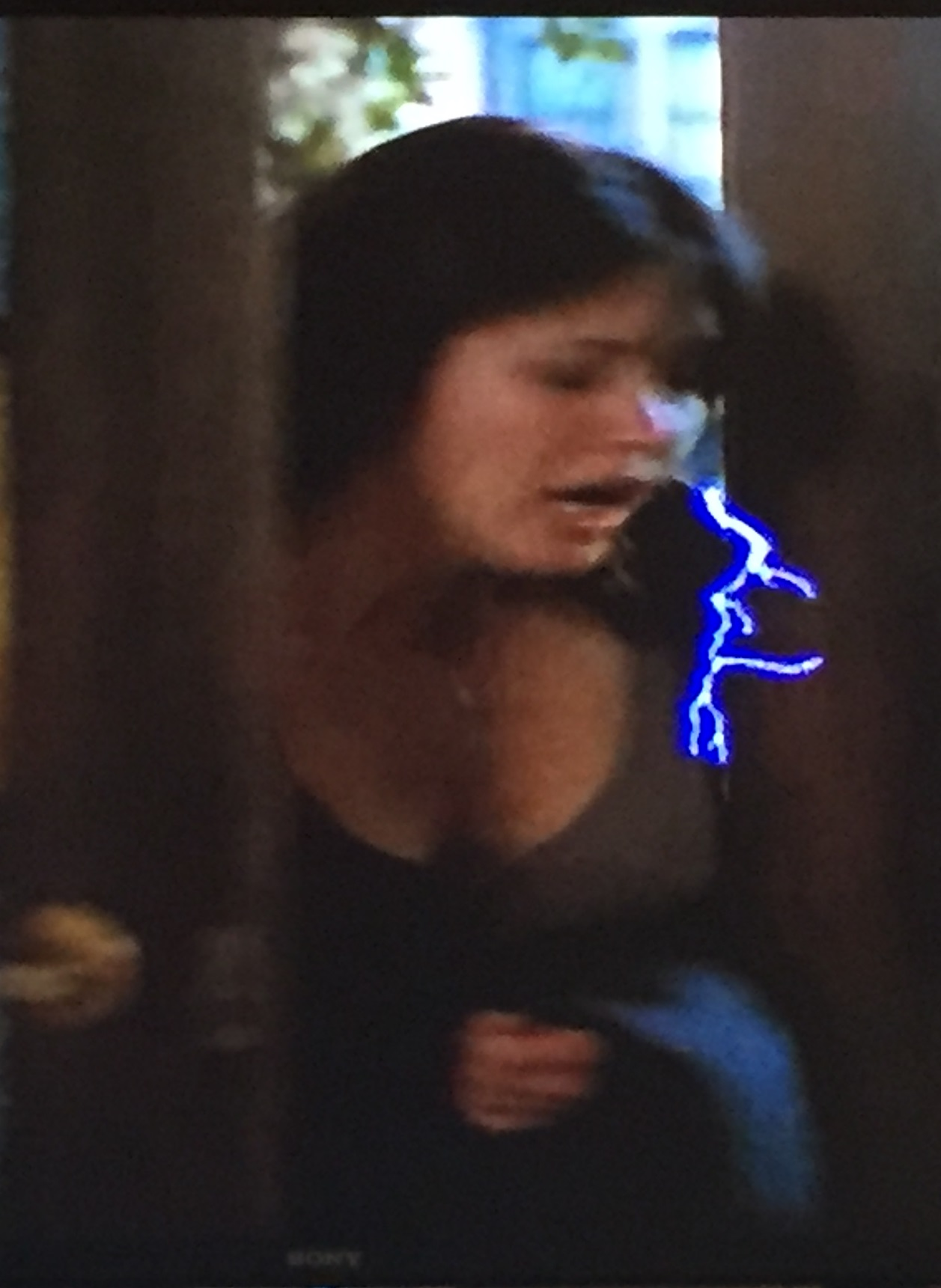 Prue gets shocked as she comes in the door.