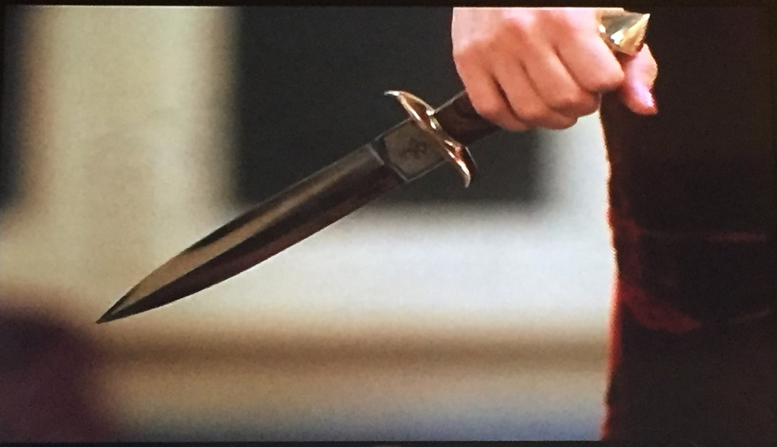 If it doesn't have a black handle, it's just a dagger.