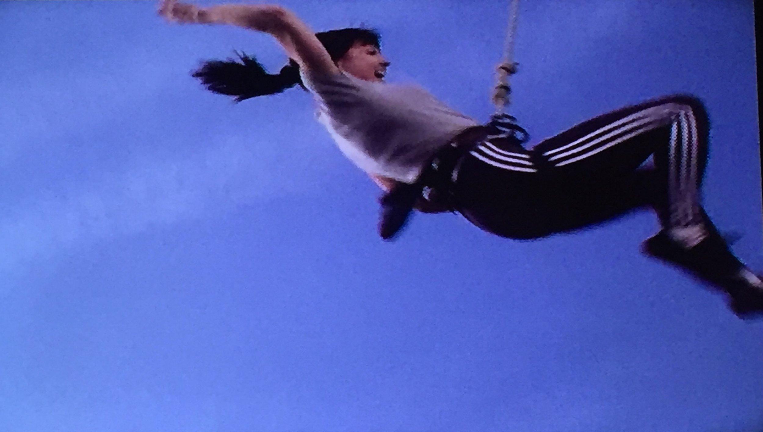 Rock climbing, er, falling stunt double.