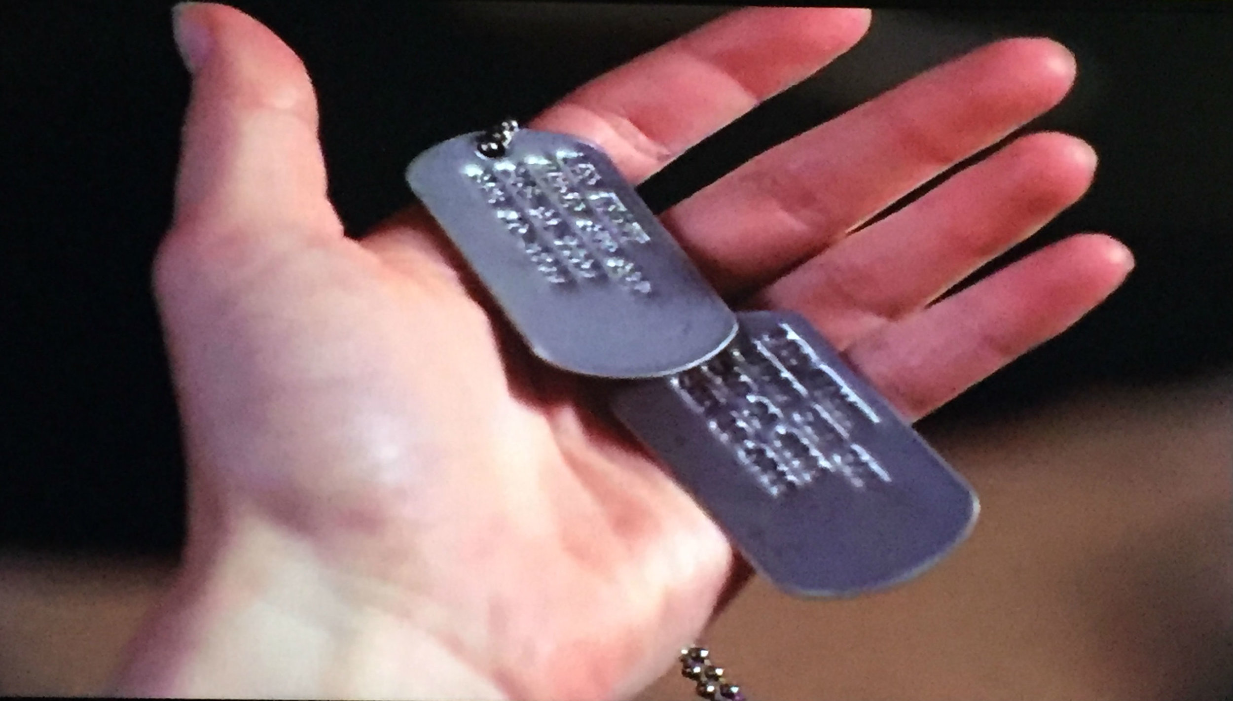 Piper finds Leo's dog tags. I wish they were easier to see, but this show was out before HD was a thing!