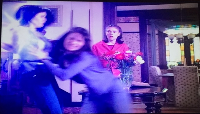 ...Piper pushes Prue out of the way...
