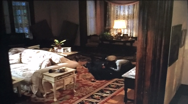 Prue cries over Andy's dead body in the living room.