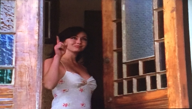 Season One Finale Shot. Prue closing the front door, with the point of a finger.