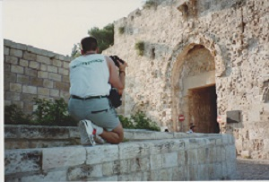 Phil Supple photographing Zion Gate in summer 1990. The bullet holes date to the war of 1948.