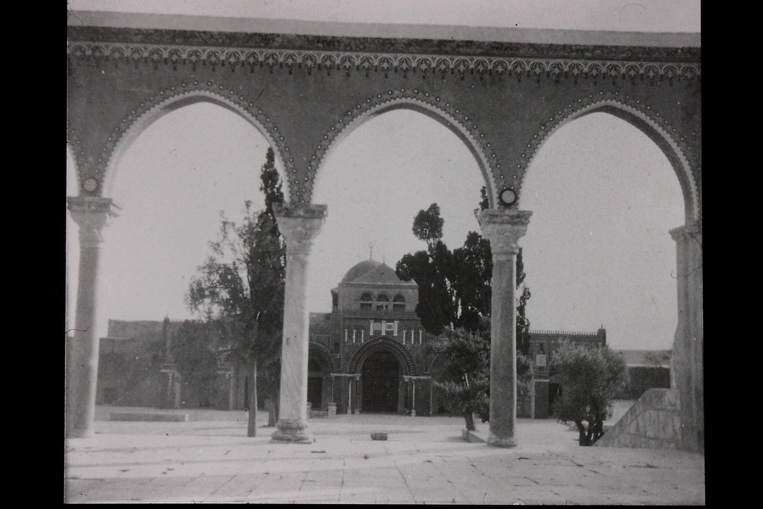 Gertrude Bell's photograph of Al Aqsa Mosque through archway. Catalogue number A51.
