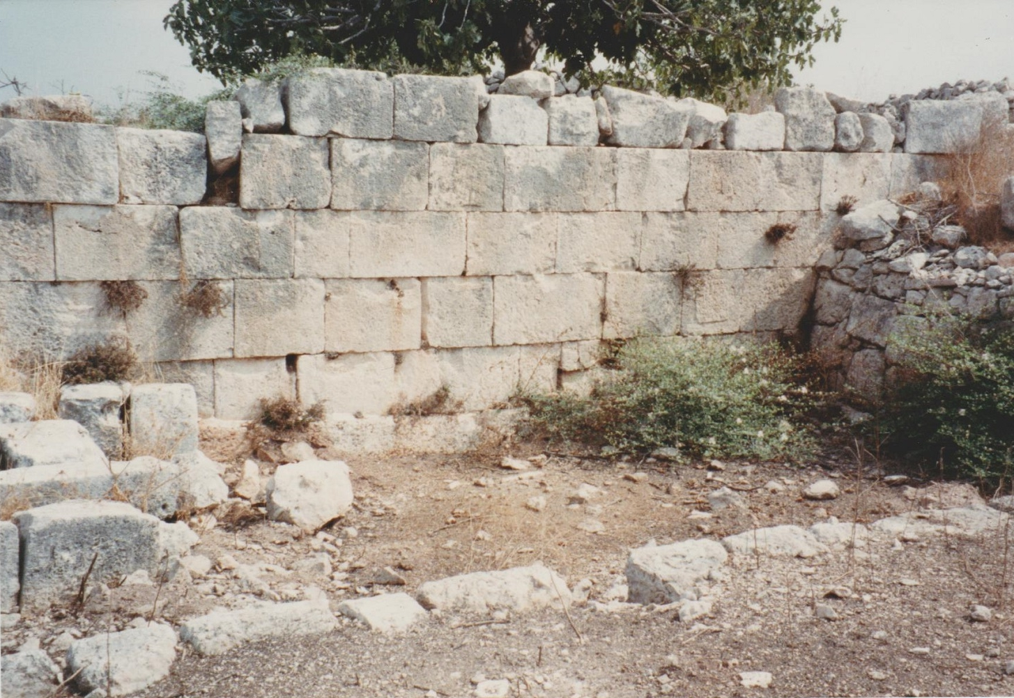 Deir Samaan, summer 1990. There is evidence of the original Roman construction, Byzantine modification and re-use, and modern uncovering of wall lines (presumably for the purposes of determining a basic plan of the site) prior to my visit of 1990. Credit: Eleanor Scott.