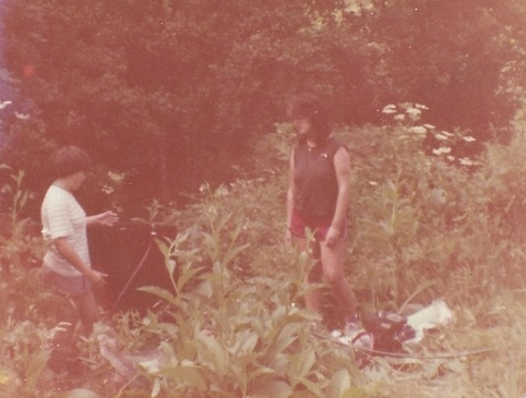 Alice, flotation machine, me - Castell Henllys, 1981, a short distance from farmhouse. The 'jungle' was cut away in subsequent years