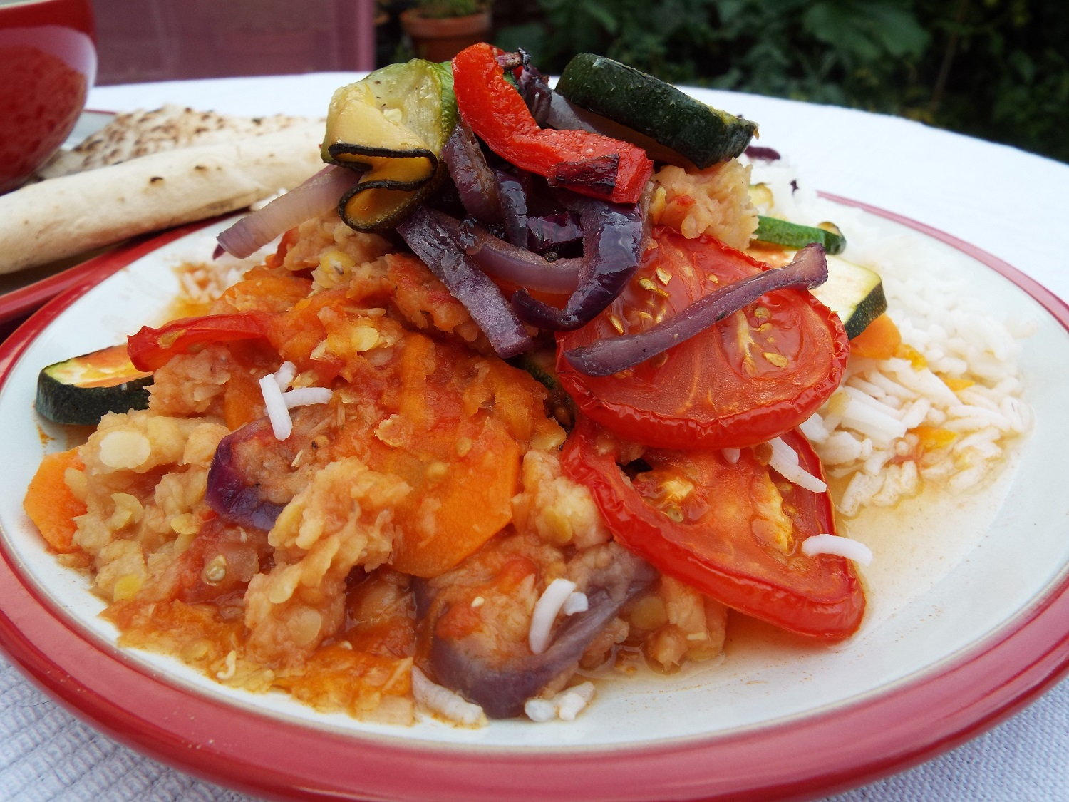 Vegetable Stack - This uses the lentil, carrot and tomato soup as a sauce over rice, and this one is topped with extra vegetables which can be either oven baked or fried - carrot slices, red onion, courgettes, red pepper and tomatoes. Any vegetables to hand can be used. Add seasoning.Serve with extra soup and flat bread (or a rye bread)to 'bulk out' dinner.