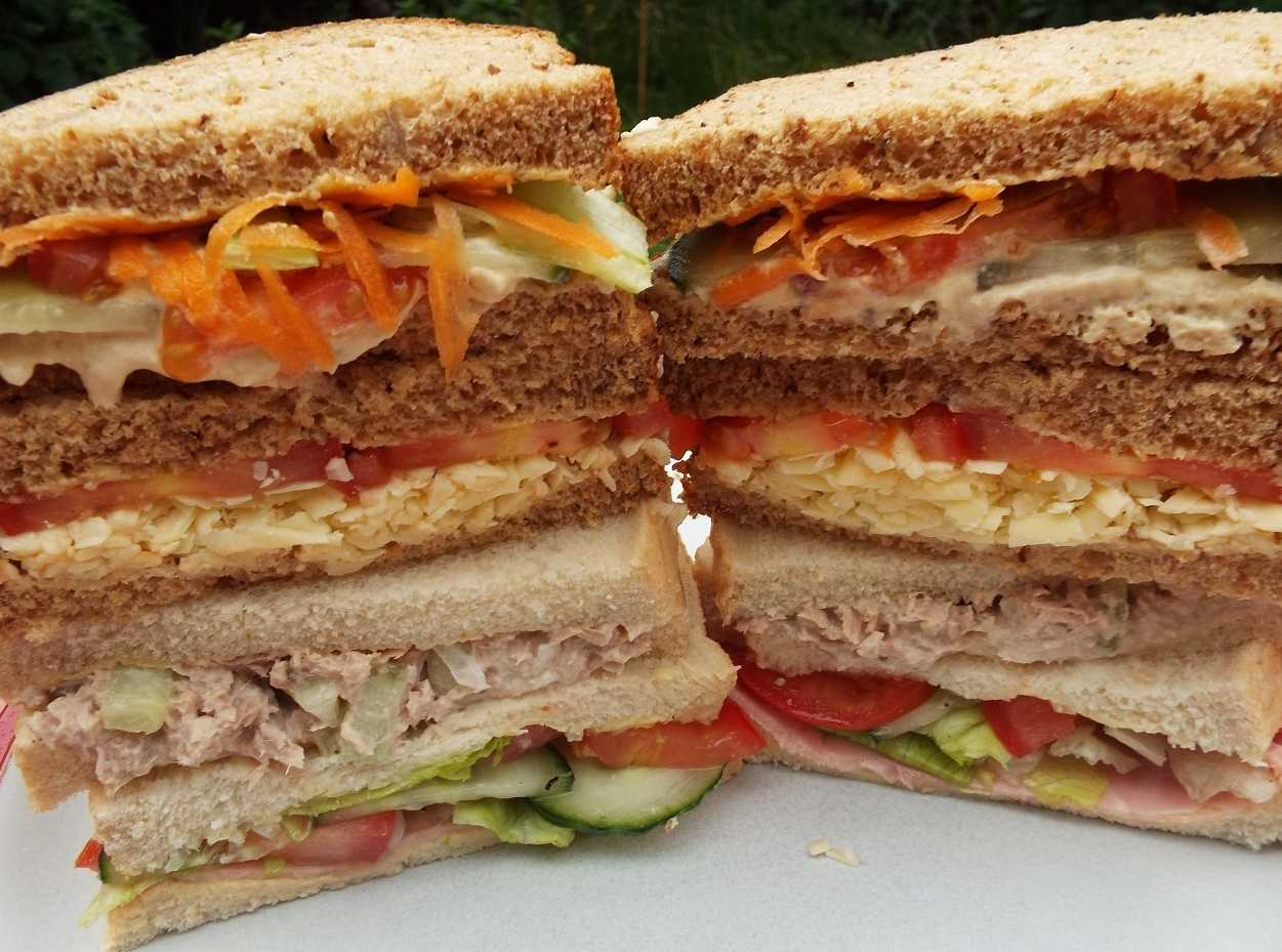 Sandwiches - They don't all have to be boring, on cheap white bread and slavered in pickled beetroot. They don't all have to have meat in them.Try hummus, salad and grated carrot; cheese and tomato; tuna, mayo and cucumber mix; ham salad.
