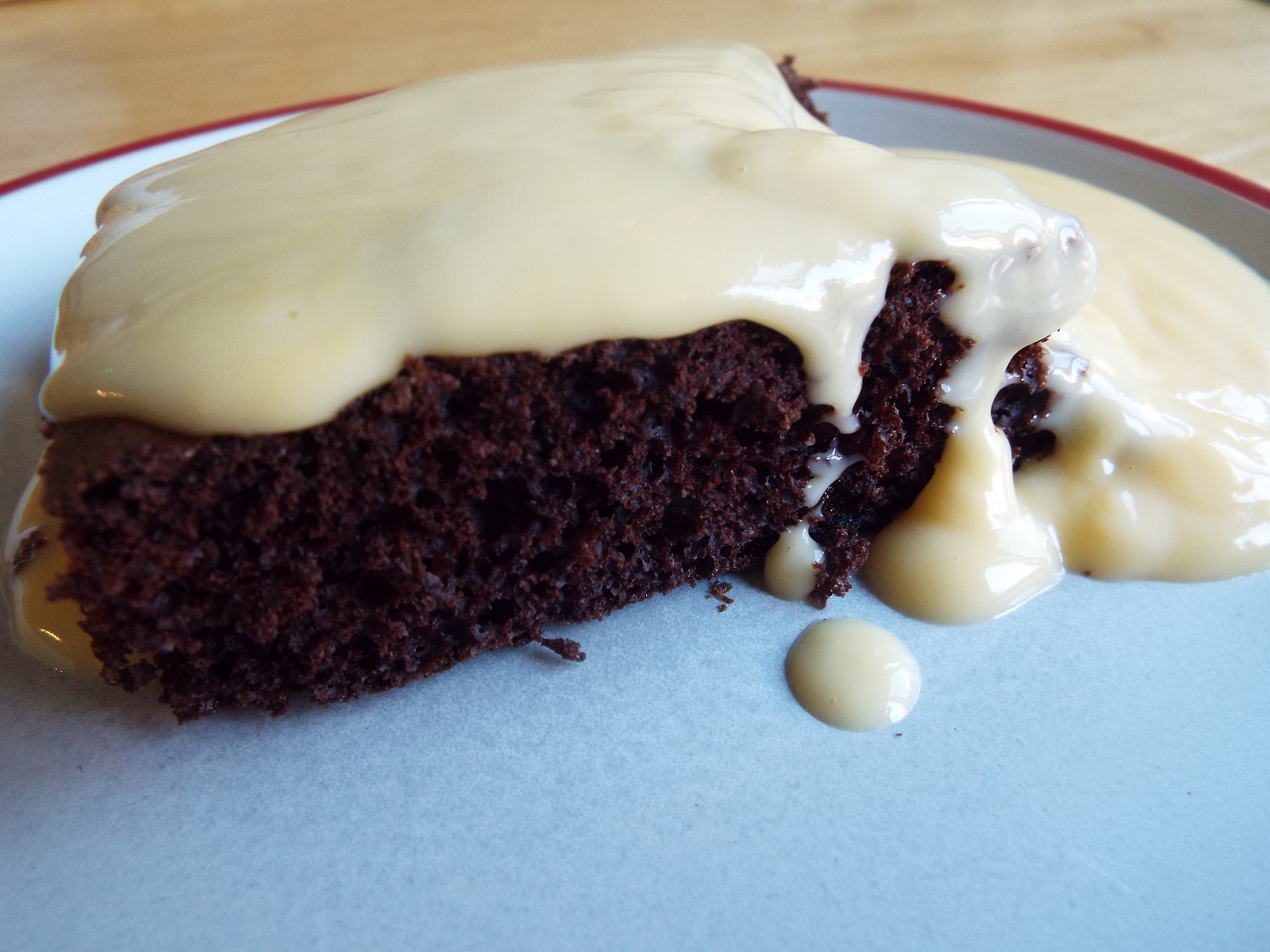 Chocolate Cake & Custard - All this came out of packets - add water and eggs.You need a large tray(s) and a large pot, and a whisk. Make the cake in advance, and serve with hot custard. At the end of a miserable digging day, it helps.